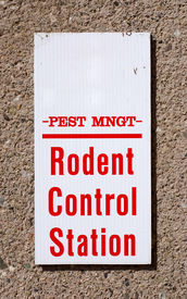 foto of pest control  - Sign reading Pest Mgmt Rodent Control Station on a wall - JPG