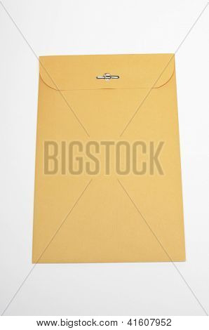 Closeup of brown confidential paper folder over white background