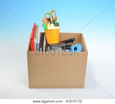 Personal belongings in cardboard box � job loss concept