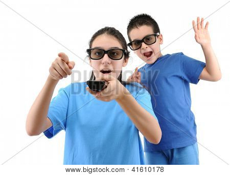 Brother and sister watching TV with remote control on hand isolated over white background