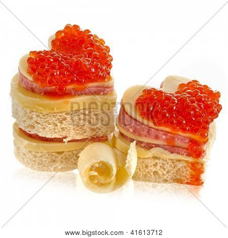 Pair heart shape of sandwich with red caviar isolated on white
