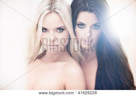 Two beautiful women posing in bleached light