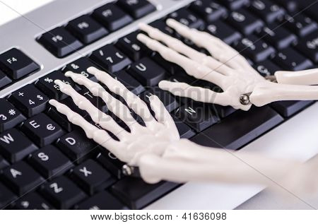Skeleton working on the keyboard
