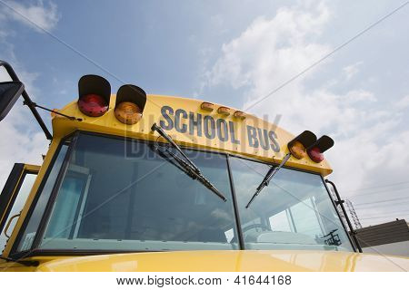 Low angle view of a school bus against sky