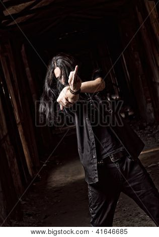 Long-haired Young Man Making Offensive Gesture (middle Finger)