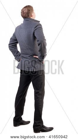 back view of Business man  looks ahead. Young guy in coat watching.  Rear view people collection.  backside view of person.  Isolated over white background.