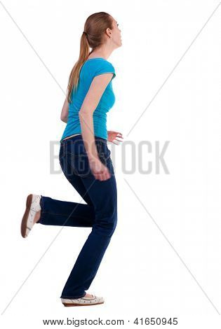 back view of running  woman  in  jeans. beautiful blonde girl in motion.  backside view of person.  Rear view people collection. Isolated over white background.
