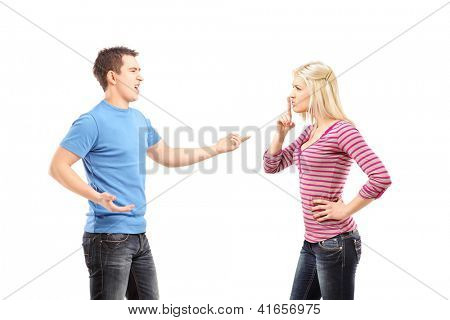 Young man shouting and woman gesturing silence isolated on white background