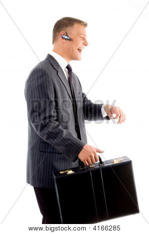 Successful Businessman Smiling And Holding Office Bag