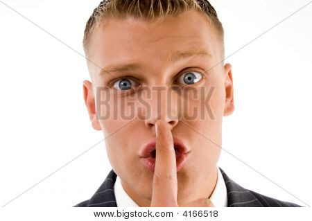 Close View Of Businessman Asking To Keep Silent