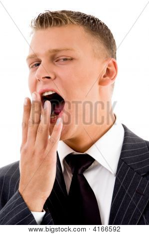Yawning Young Manager