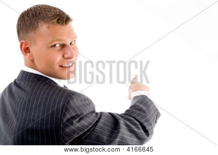 Smiling Handsome Employee Pointing Back Side