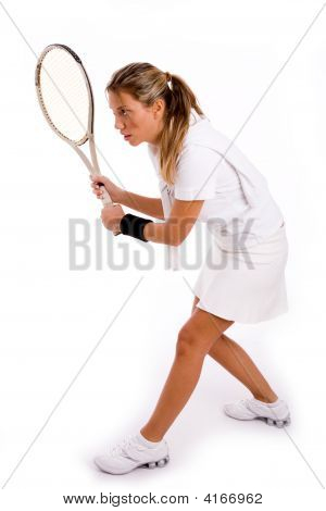 Side View Of Young Player Ready To Play Tennis