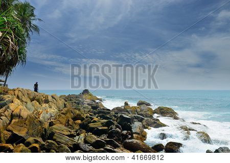 Man On A Rocky Shore