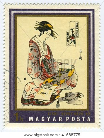 HUNGARY - CIRCA 1971: A stamp printed in Hungary shows image of Japanese woman with scroll painting, circa 1971.