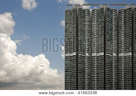 High Apartment Blocks And Plane