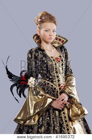 Teen age girl in carnival costume with mask