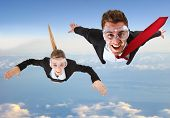 Portrait of funny business people skydiving
