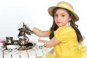 picture of tea party  - young lady dress for tea in brite yellow with hat - JPG