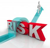 A person jumps over the word Risk to symbolzine avoiding danger or hazards and being careful and pre