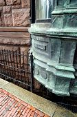 stock photo of brownstone  - An exterior architectural detail of a brownstone with an ornate copper - JPG