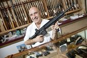 stock photo of gun shop  - Portrait of a happy middle - JPG
