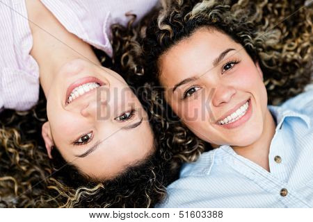 Portrait of a couple of happy twin sisters smiling
