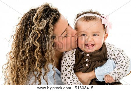 Beautiful portrait of a mother kissing her daughter - isolated over white