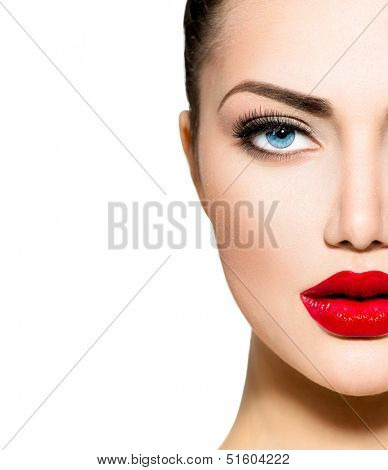 Beauty Woman Portrait. Professional Makeup for Brunette with Blue eyes - Red Lipstick, Smoky Eyes. Beautiful Fashion Model Girl. Perfect Skin. Make up. Isolated on a White Background. Part of face