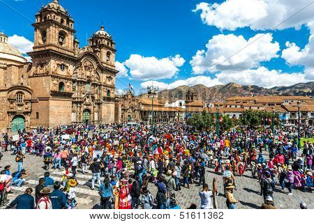 Cuzco, Peru - July 12, 2013: people at festival  in the Plaza de Armas at Cuzco Peru on july 12th, 2013. This plaza has been the scene of the proclamation by Francisco Pizarro in the conquest of Cuzco