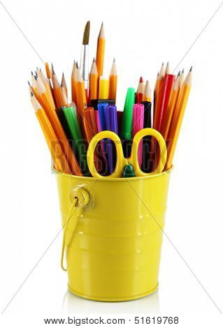 Colorful pencils and other art supplies in pail isolated on white