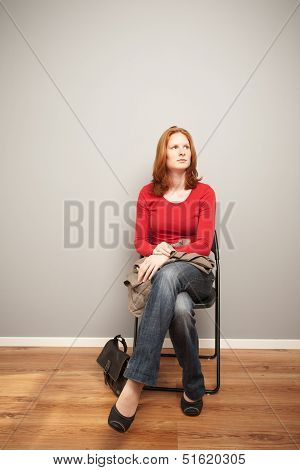Woman Waiting On A Chair