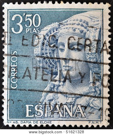 A stamp printed in Spain shows Dama de Elche