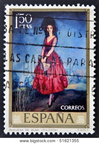 A stamp shows a painting of the Duchess of Alba with mantilla and red dress by Ignacio Zuloaga