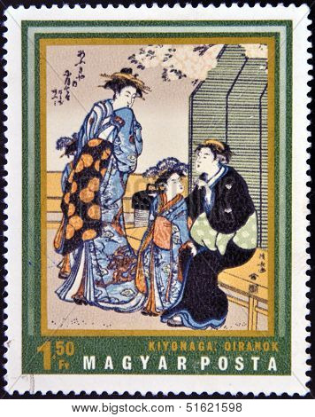 A stamp printed in Hungary shows Courtesans by Kiyonaga
