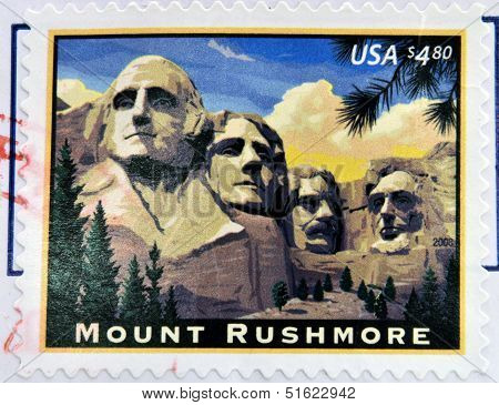 A stamp printed in USA shows image of the Mount Rushmore National Memorial