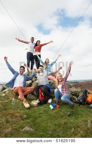 Group Of Young People Hiking In Countryside