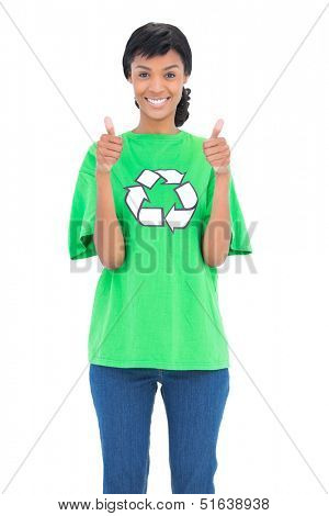 Joyful black haired ecologist posing giving thumbs up on white background