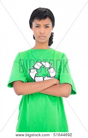 Irritated black haired ecologist posing with crossed arms on white background