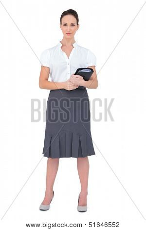 Content businesswoman holding datebook on white background
