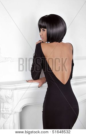 Vogue Style. Fashion Beauty Woman In Sexy Dress Showing Back. Brunette Lady With Black Short Hair St