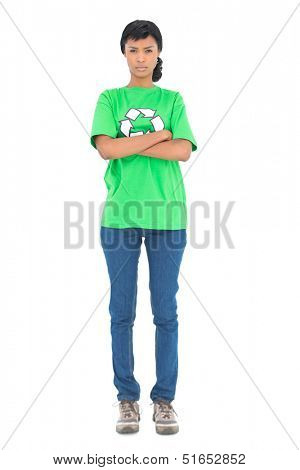 Frowning black haired ecologist posing with crossed arms on white background