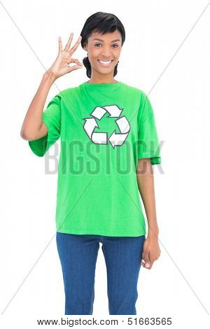 Pretty black haired ecologist making an okay gesture on white background