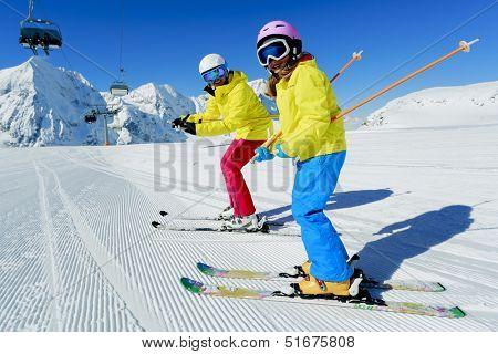 Ski, ski resort, winter sports - family on ski vacation