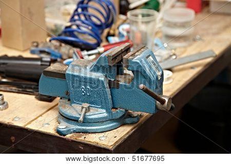 Old vise on a workshop table