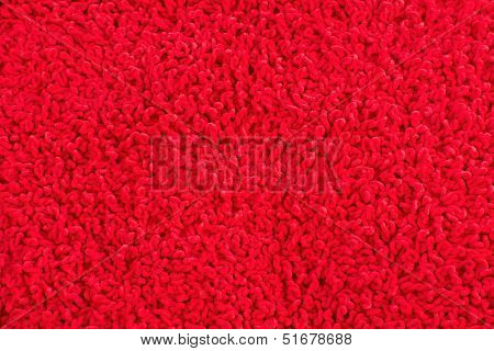 Fleecy red pillow close-up background