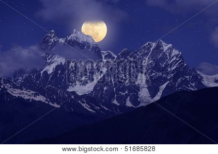 Night landscape with the mountains and the full moon