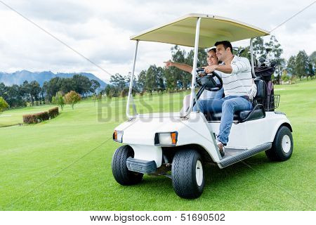 Group of players in a golf cart at the course
