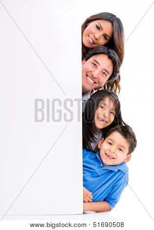 Happy family with a banner - isolated over a white background