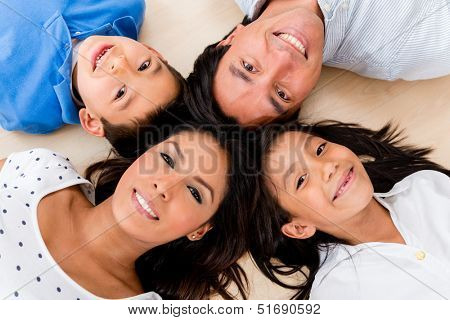 Beautiful portrait of a hispanic family with heads together